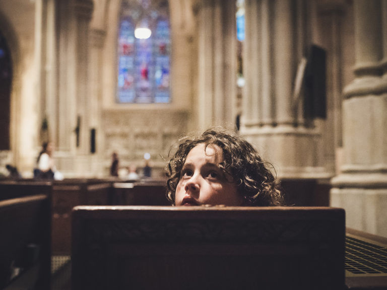 Image of a boy in church at St Patrick's Cathedral