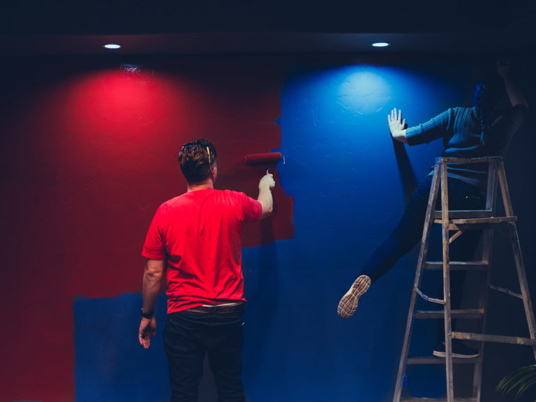 Image of people painting a blue and red wall