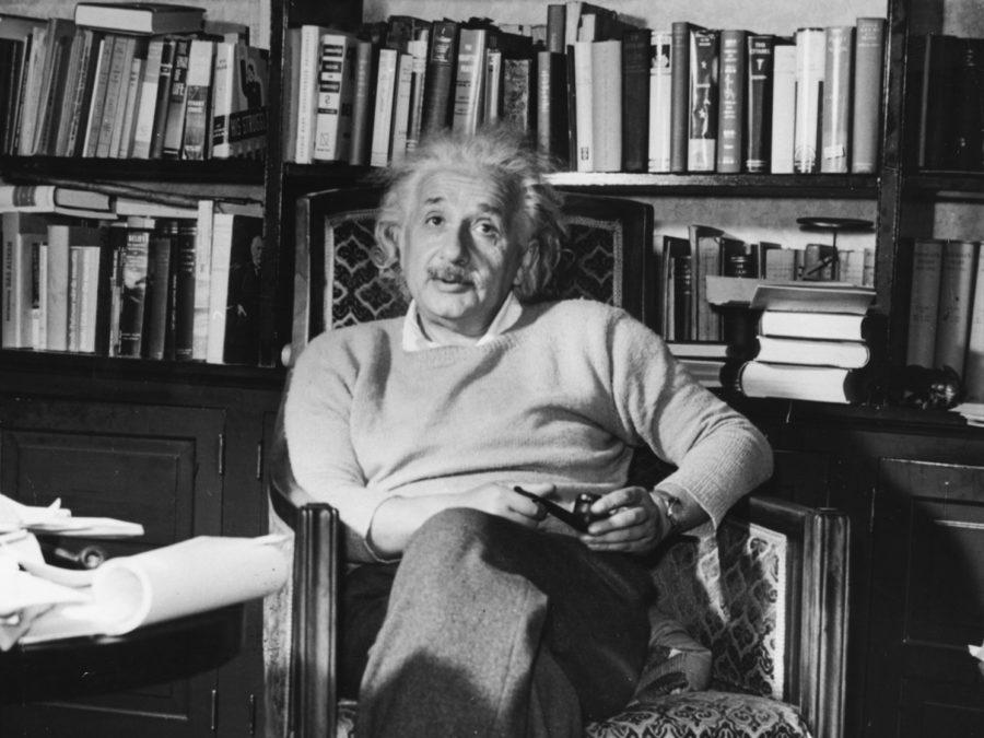 Portrait of physicist Albert Einstein sitting in an armchair with a pipe, circa 1934.
