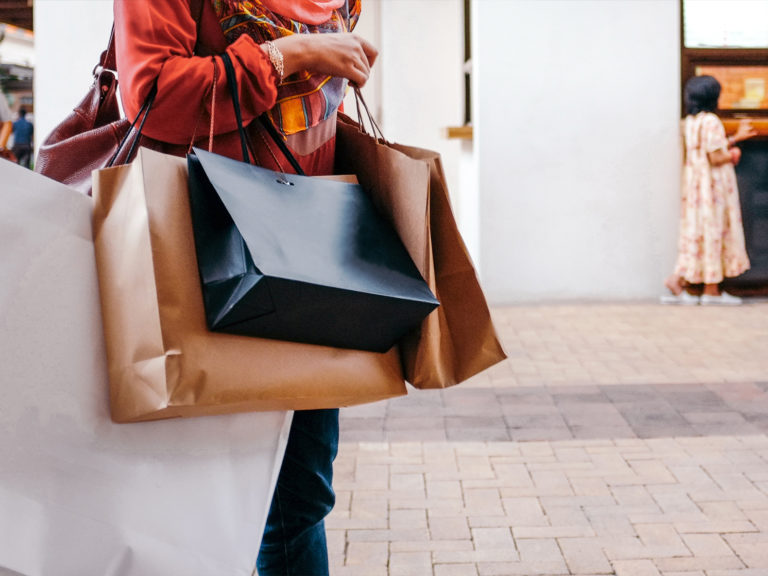 Image of woman holding shopping bags