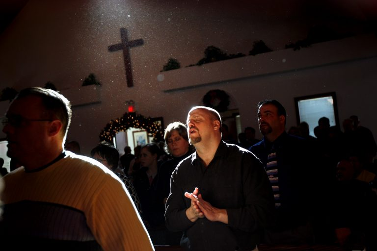 A man sings during a a prayer service at the Wilmington Church of God a Pentecostal congregation in Ohio.