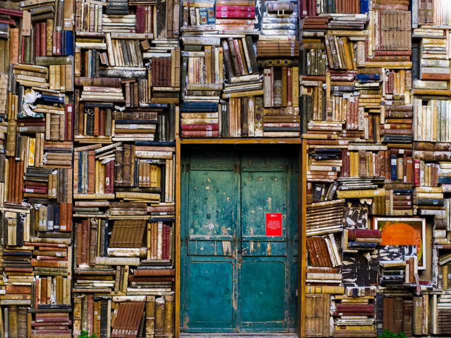 Image of wall of books around a door
