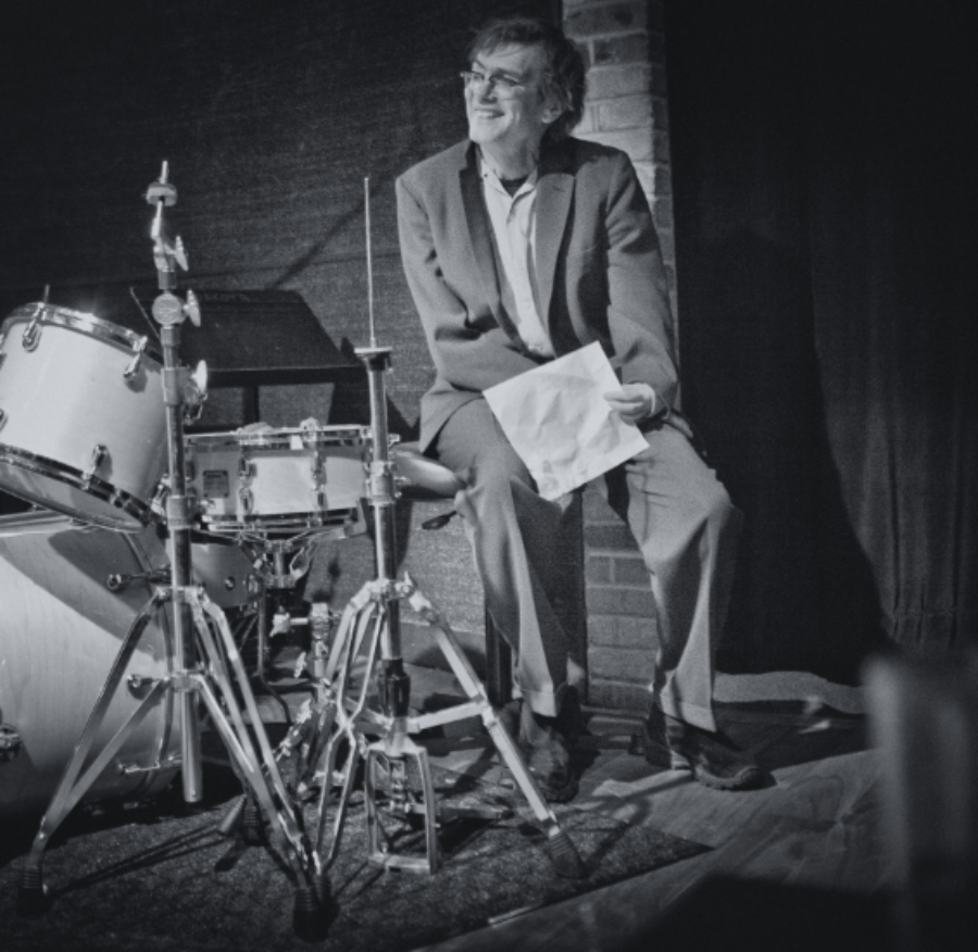Kevin Kling sits by a drum set