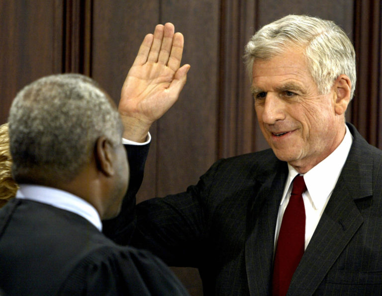 U.S. Supreme Court Justice Clarence Thomas swears in former Republican U.S. Senator John Danforth as the U.S. Ambassador to the United Nations on July 1, 2004.