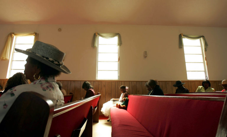 African-American worshipers sit during services at New Macedonia Baptist Church October 31, 2004 in Riviera Beach, Florida. The church bused voters to an early polling location after services because there are no early polling places in their neighborhood. Most of the voters left the polling location on the buses without voting due to four-hour lines.