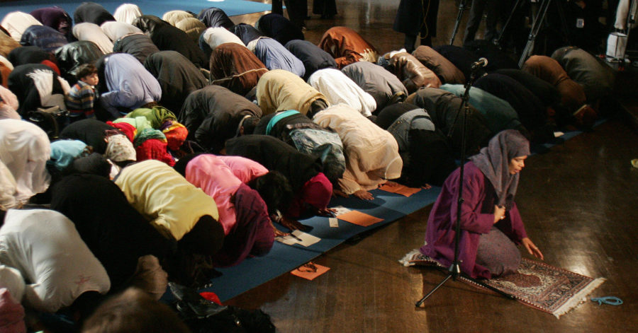 On March 18, 2005, Amina Wadud (right, kneeling), a professor of Islamic studies at Virginia Commonwealth University, leads both men and women in prayer at Synod House at the Cathedral of St. John the Divine in New York. Her action has drawn sharp criticism from Muslim religious leaders.