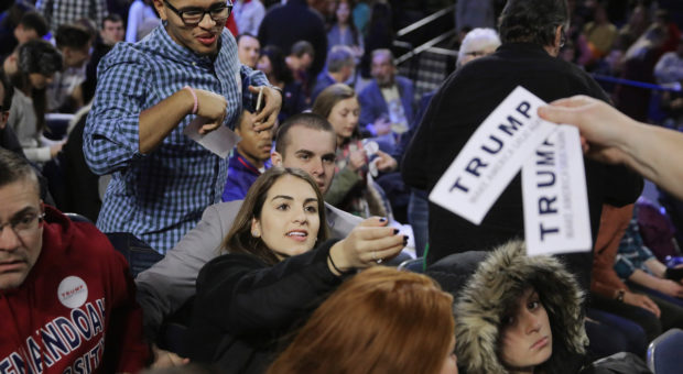 LYNCHBURG, VA - JANUARY 18: Supporters of Donald Trump reach for bumper stickers before the Republican presidential candidate delivers the convocation at the Vines Center on the campus of Liberty University on January 18, 2016 in Lynchburg, Virginia. A billionaire real estate mogul and reality television personality, Trump addressed students and guests at the non-profit, private Christian university that was founded in 1971 by evangelical Southern Baptist televangelist Jerry Falwell. (Photo by Chip Somodevilla/Getty Images)