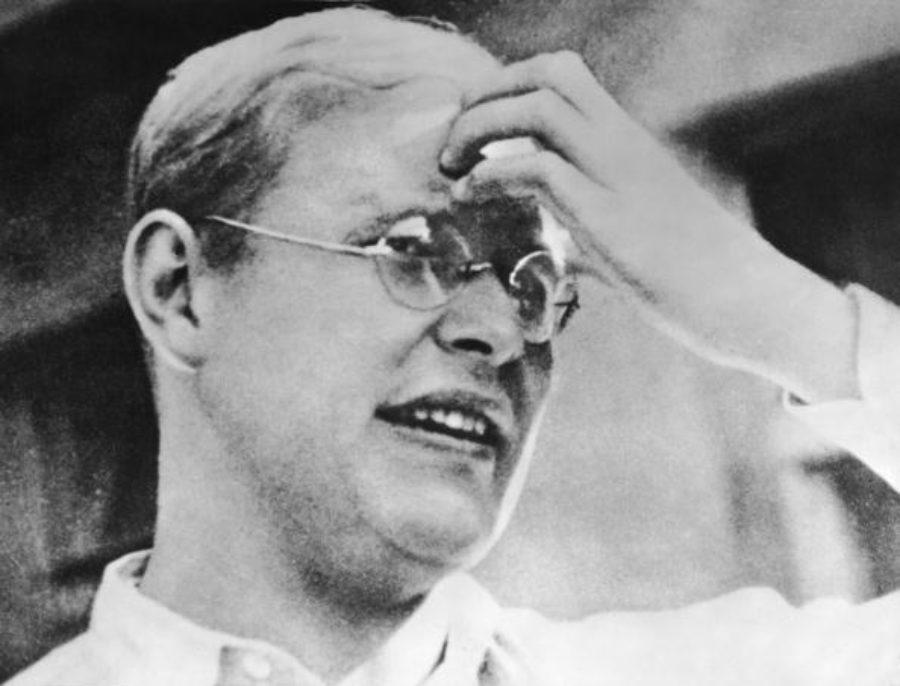 Headshot portrait of German religious leader and resistance participant Dietrich Bonhoeffer (1906 - 1945), who touches his forehead, early to mid 1930s. An outspoken critic of the Nazi regime, the Lutheran pastor and theologian was ultimately hanged at Flossenburg Concentration Camp.