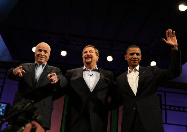 Presumptive U.S. Presidential candidates John McCain and Barack Obama greet the crowd alongside Rick Warren before the start of the