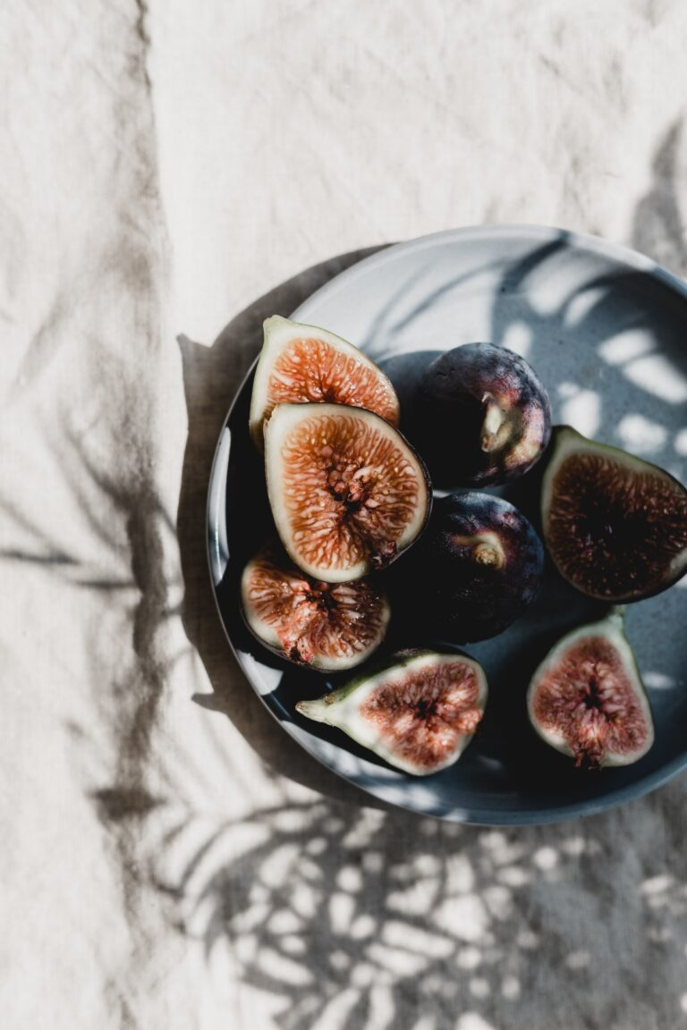 A plate of figs sits in the afternoon sunlight.