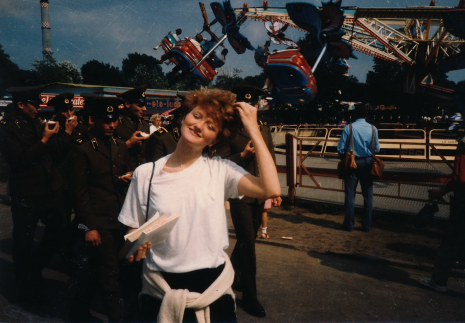 Krista Tippett stands in front of an amusement park in Germany in the 1980s.